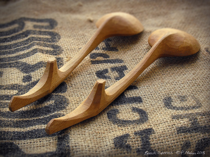 Spoons hand carved beech wood by P Maton handle detail on hessian background