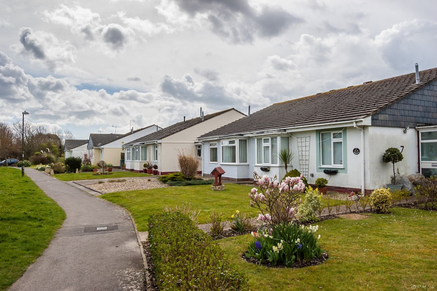 Suburban bungalows with gardens and dramatic cloudy sky Middle Mead Littlehampton