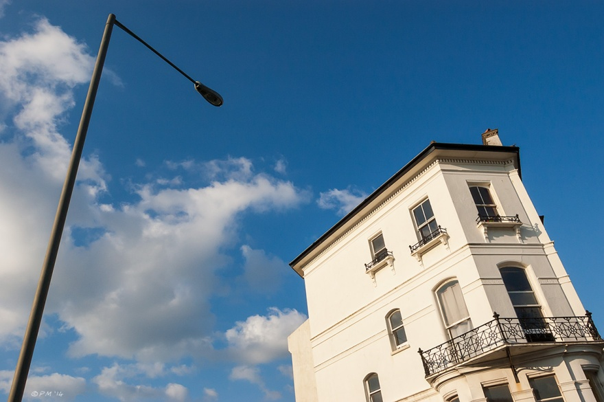 Corner house Dyke Road Compton Avenue Brighton looming victorian town house and lamp post in sunshine blues sky clouds.