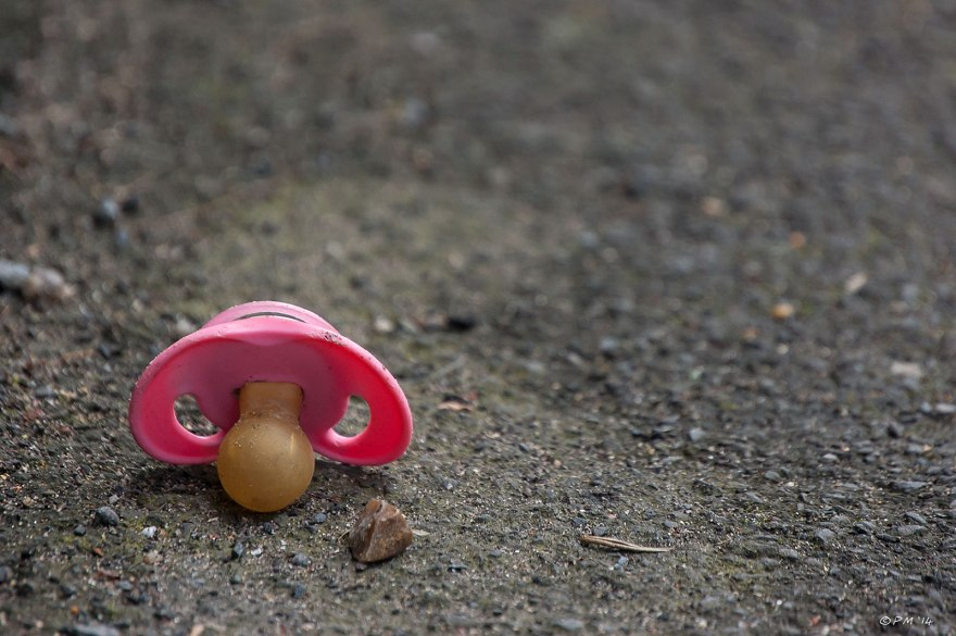 Pink Baby's Dummy dropped on tarmac footpath 22/4/14