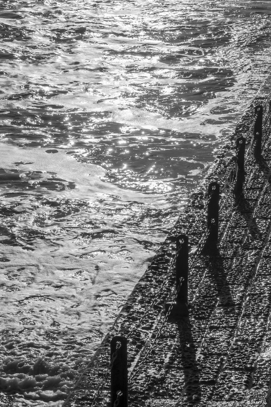 Abstract sunlight on sea with concrete Groyne and posts casting shadows, Hove black & white 2014 eyeteeth.net