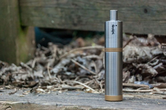 Nahualon Atomiser, Versa Mod, high end e-cigarette standing on bench with dead leaves in background. 2014 eyeteeth.net