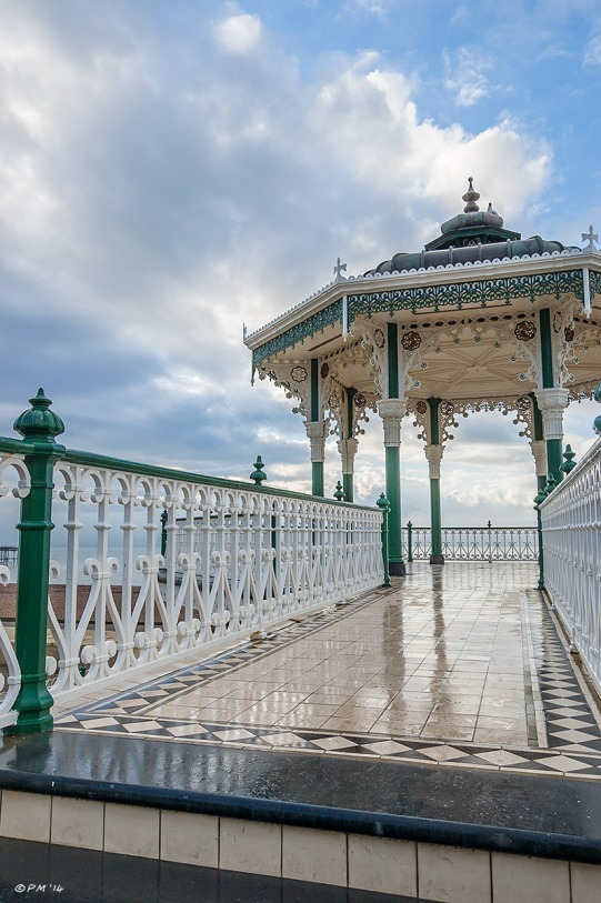 Bandstand on Brighton seafront promenade against blues sky and clouds wet tiled walkway after rain Brighton street photography 2014 eyeteeth.net