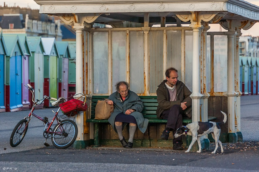 Mother and son sitting in victorian shelter with bike and dog at dusk, Hove Lawns Sussex Brighton street photography 2014 eyeteeth.net