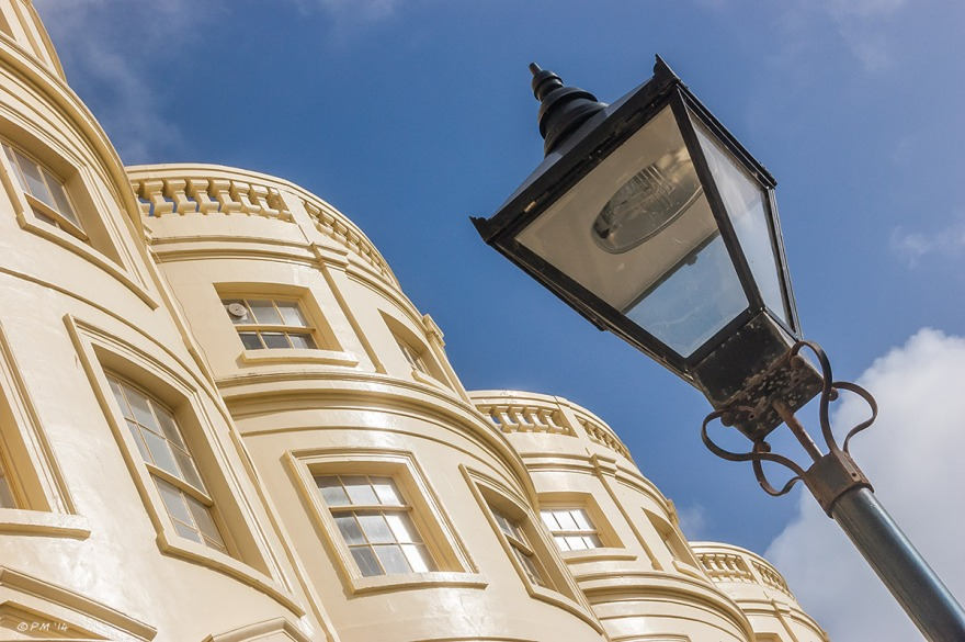 Regency town houses in Brunswick square Brighton with victorian street lamp against blue sky 2014 eyeteeth.net