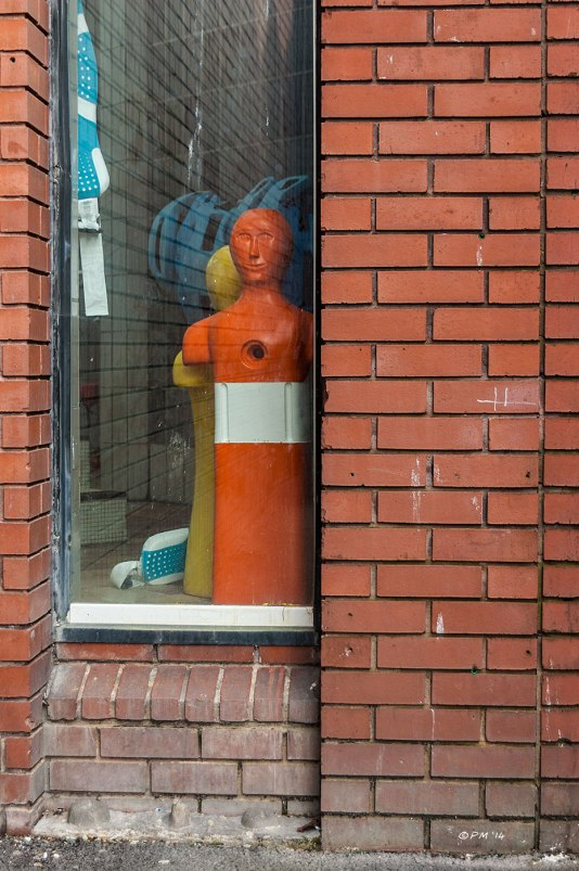 Orange & White Swimming Pool Dummy in window red brick wall abstract street photography Prince Regent Swimming Complex Brighton 2014 eyeteeth.net