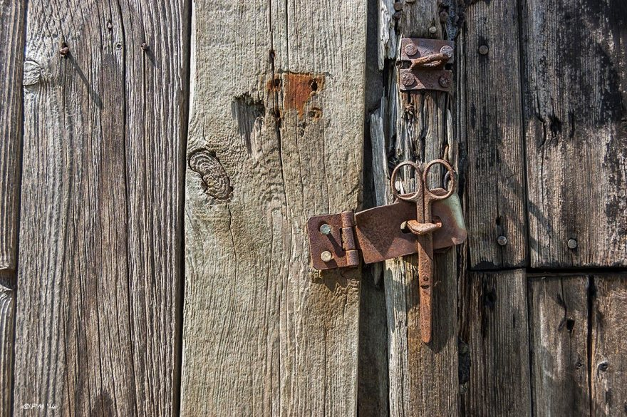 Rusty Hasp with scissors used as lock, old distressed wood, abstract. Colour. eyeteeth.net 2014