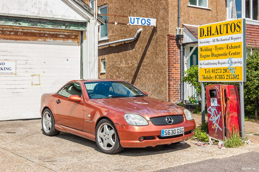 Mercedes Compressor on forecourt of shabby garage with broken signs and old petrol pump, Hove, UK, eyeteeth.net 2014