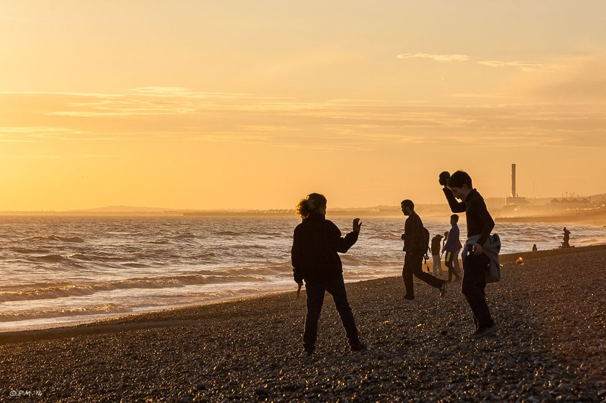 People silhouetted against golden sunset on Brighton and Hove beach 2014 eyeteeth.net