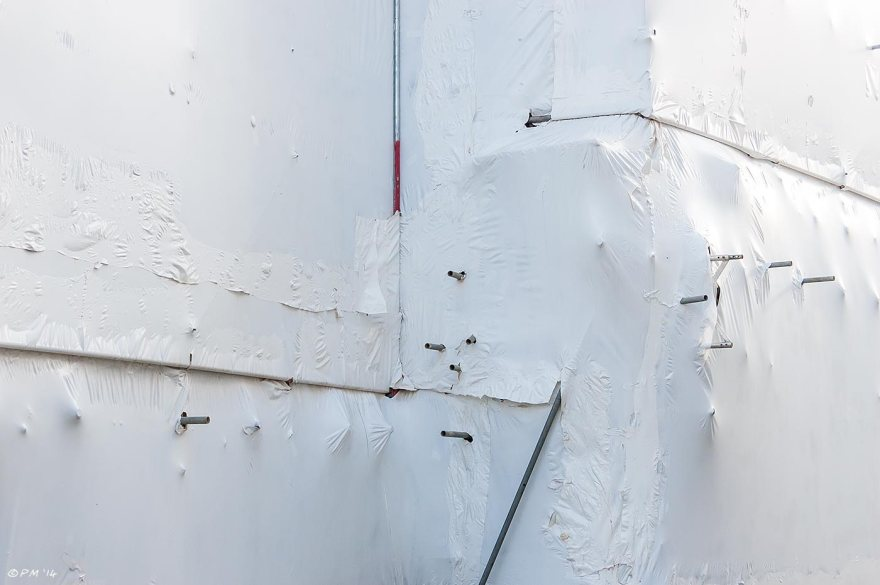 Scaffolding shrouded in white plastic sheeting with exposed framework, abstract urban building site eyeteeth.net 2014
