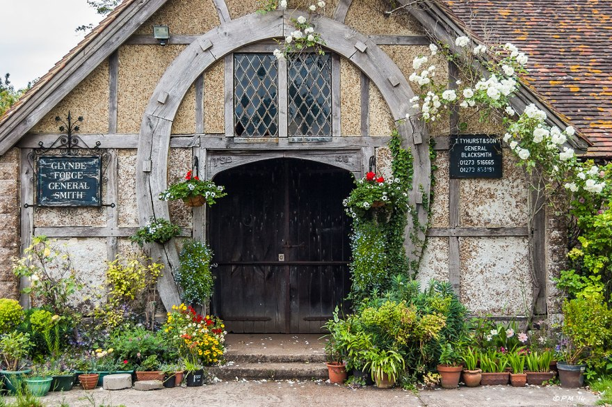Glynde Forge doorway with wooden beams forming horseshoe and pot plants historic sussex  T. Tyhurst & Sons South Downs National Park 2014 eyeteeth.net