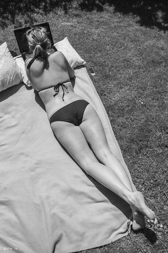 Woman in bikini lying on rug with laptop in sunshine from above black and white Hove Brighton street photography glamour beauty 2014 eyeteeth.net