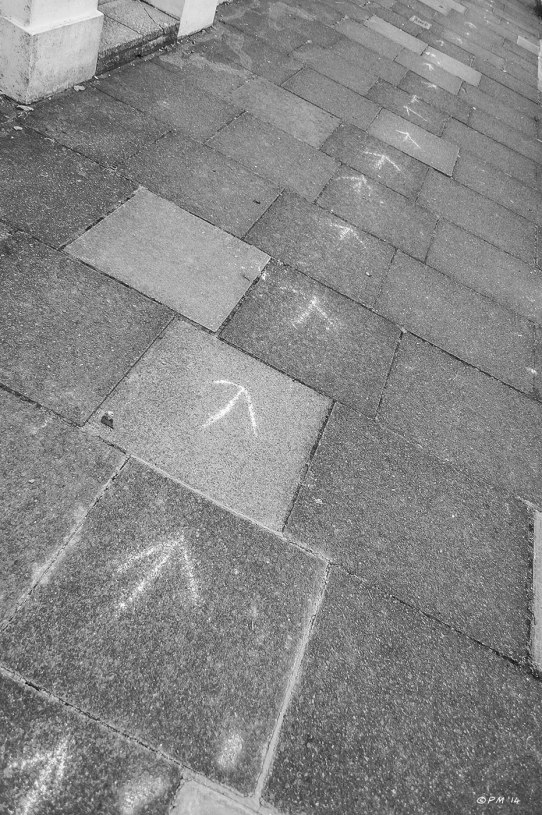 Chalk arrows drawn on paving slabs monochrome abstract Hove P.Maton 2014 eyeteeth.net