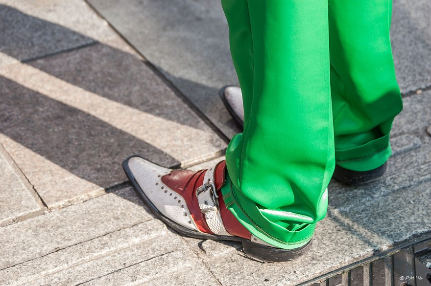 Close up of a mans feet in red and white snake skin winkle picker shoes and green trousers, Brighton street photography UK 2014 eyeteeth.net