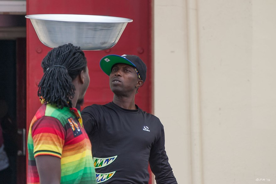 Two African street performers with spinning bowl hovering between them Brighton 2014 eyeteeth.net