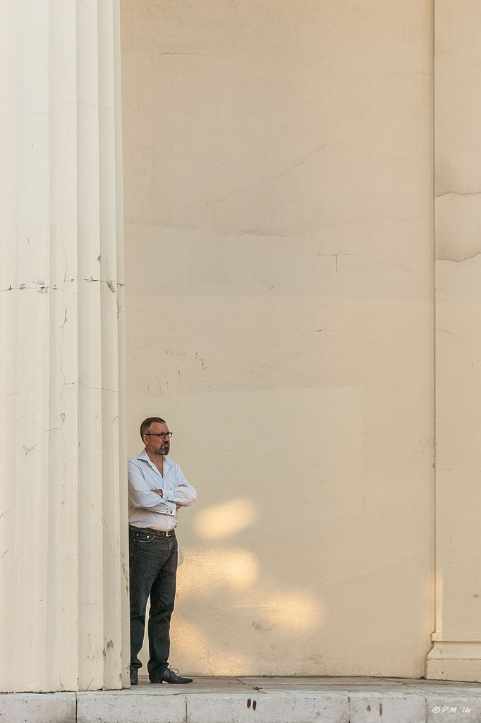 Man standing at the foot of a pillar on steps of Brighton Unitarian Church abstract urban 2014 eyeteeth.net