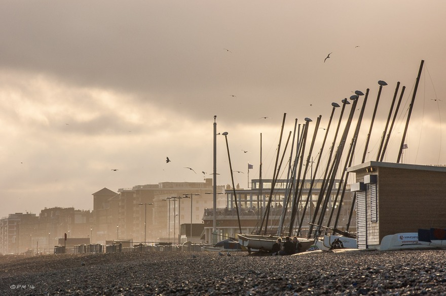 Hazy evening view West along Brighton Seafront with beached boats Sussex PMaton 14-07-2014 eyeteeth.net