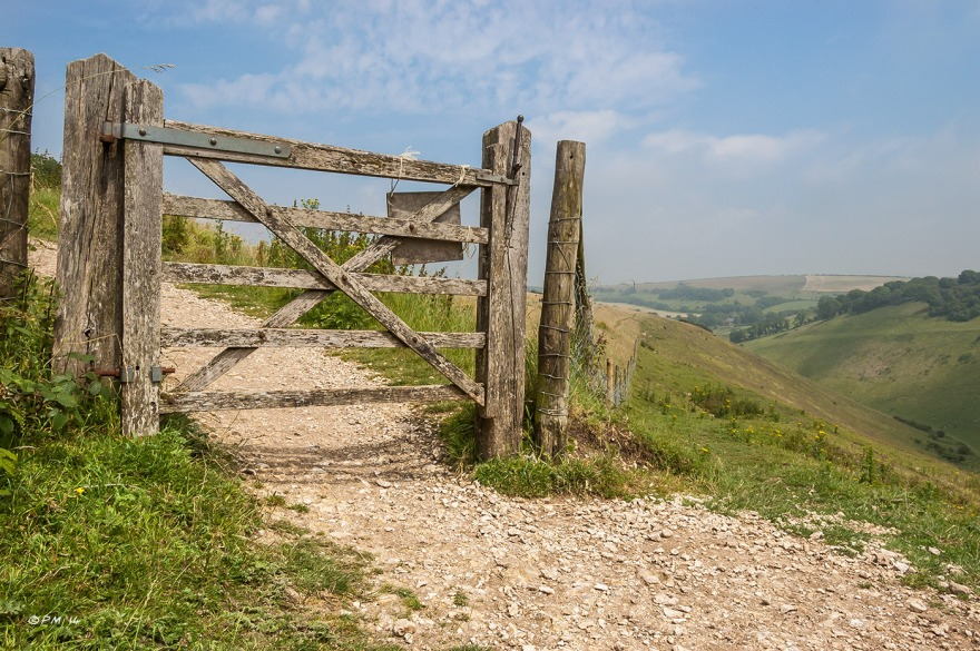 Landscape with weathered wooden gate over chalk path on hillside at Devil's Dyke South Downs National Park, West Sussex UK P.Maton 2014 eyeteeth.net
