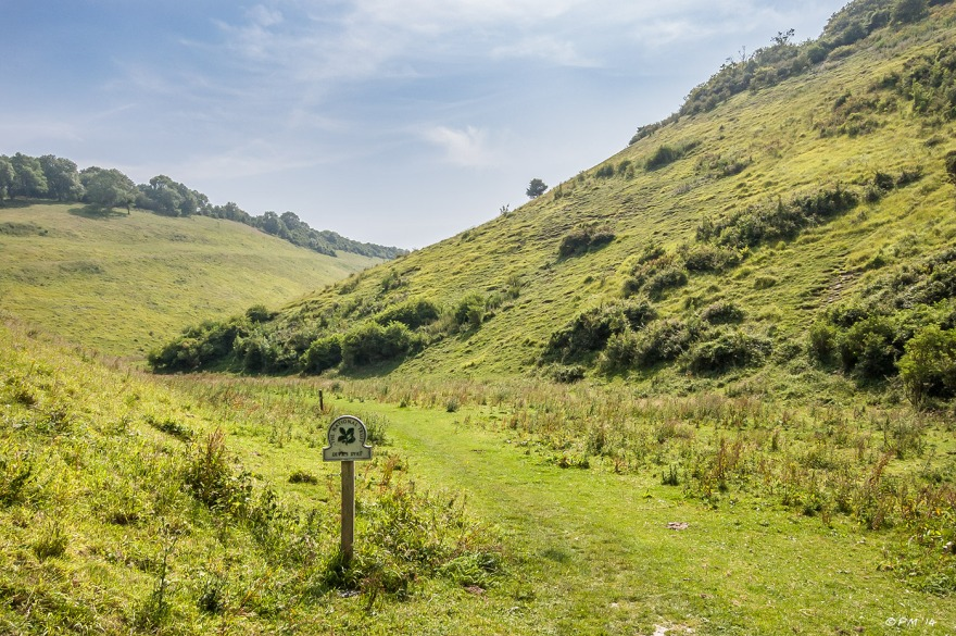 Landscape view along Devil's Dyke with National Trust sign in foreground South Downs National Park West Sussex UK P.Maton 2014 eyeteeth.net