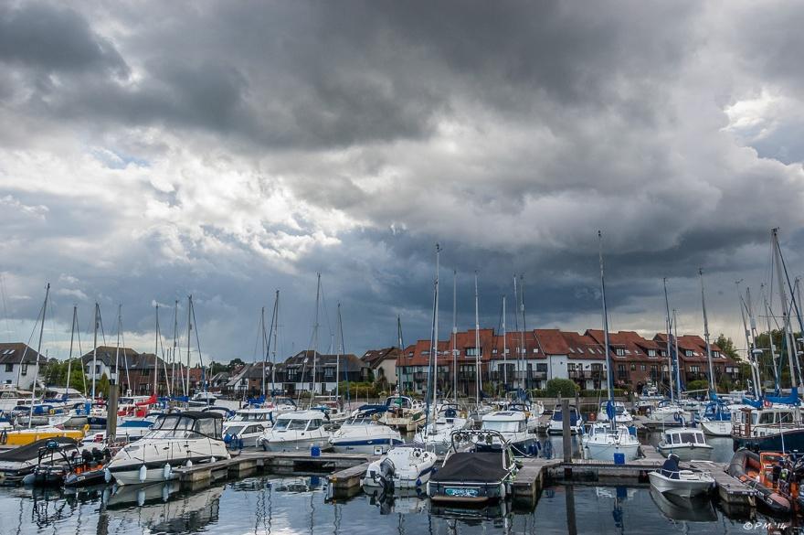 Sailing boats moored with dramatic sky Hythe Marina Village, Hampshire UK P.Maton 2014 eyeteeth.net