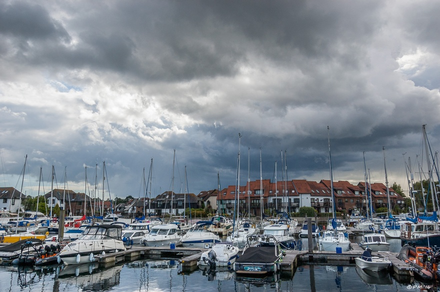 Sailing boats moored with dramatic sky Hythe Marina Village, Hampshire UK P.Maton 2014 eyeteeth.net