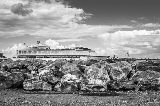 Royal Carribbean Ship Adventure on the Seas leaving port on Southampton Water shot from Hythe Marina Village with boulders in foreground Hampshire UK Monochrome Landscape. ©  P. Maton 2014 eyeteeth.net