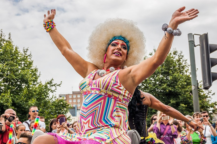 Drag queen in bright dress with mirror balls in parade at Gay Pride Brighton UK P. Maton 2014