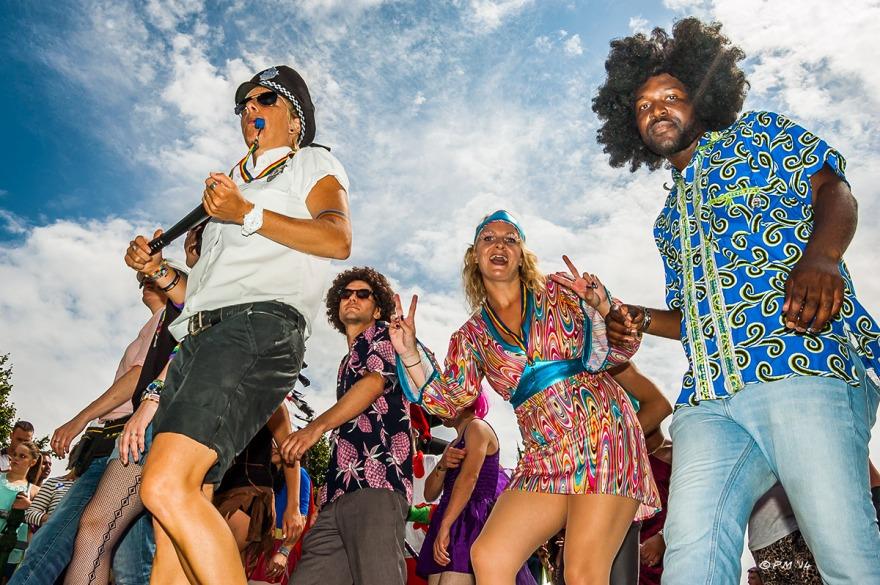 Dancing people in parade at Gay Pride Brighton UK P. Maton 2014