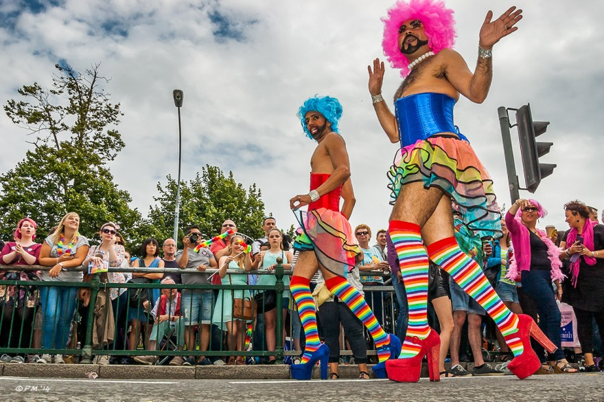 Drag Queens in parade at Gay Pride Brighton UK with onlookers in background P. Maton 2014