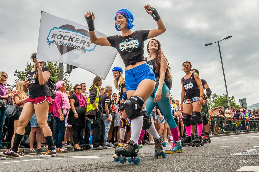 Girls rollerskating in parade at Gay Pride Brighton UK P. Maton 2014