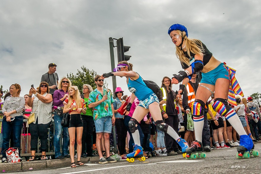 Girls in hot pants rollerskating  in parade at Gay Pride Brighton UK P. Maton 2014