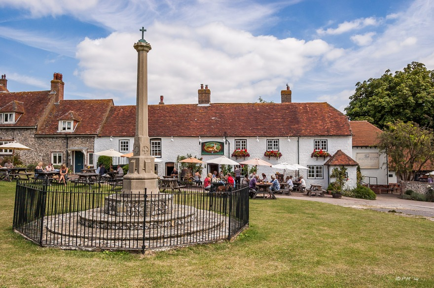 East Dean village green showing war memorial and The Tiger Inn, East Sussex, UK. Seven Sisters Country Park. Colour landscape on sunny day P. Maton 2014 eyeteeth.net
