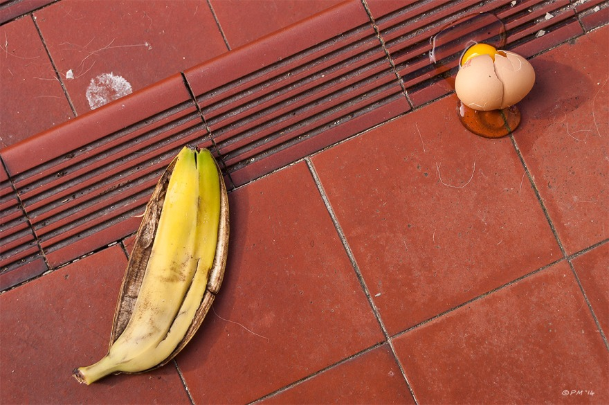 Banana skin and broken egg on red ceramic steps, colour, Brighton UK. P.Maton 2014 eyeteeth.net
