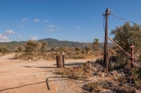 Barrel and cable mast beside dirt road. Patara Turkey. Landscape Colour. P.Maton 2014 eyeteeth.net