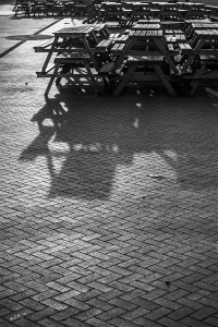 Stacked bench tables on Brighton seafront cast shadows in morning light, abstract monochrome. Brighton East Sussex UK. P.Maton 2014 eyeteeth.net