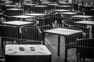 Bin with tables and chairs outside bar on Brighton seafront. Monochrome abstract. Brighton East Sussex UK. P.Maton 2014 eyeteeth.net