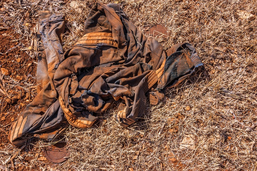 Abandoned jogging bottoms in red soil with dead grasses. Patara Gelemis Turkey. P.Maton 2014 eyeteeth.net