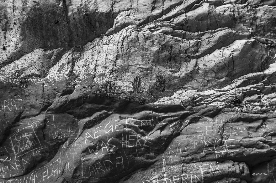 Graffiti Writing in dried mud on wall of Saklikent Gorge, Fethiye, Turkey. Monochrome abstract. P.Maton 2014 eyeteeth.net