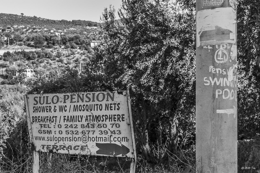 Roadside signs advertising Pension guest houses. Monochrome Landscape. Patara Village Turkey ©P.Maton 2014 eyeteeth.net