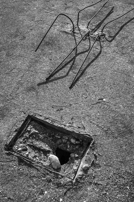 Bent rebar and square hole in concrete roof, monochrome abstract. Patara, Turkey. P.Maton 04/09/2014 eyeteeth.net