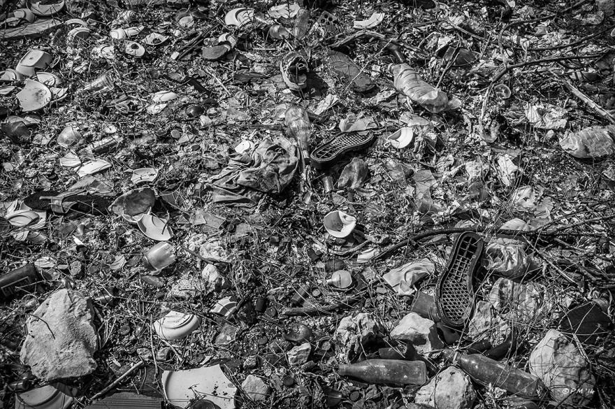 Rubbish Refuse strewn on ground. Monochrome Landscape. Patara Village Turkey ©P.Maton 2014 eyeteeth.net
