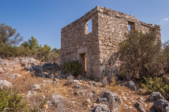 Abandoned stone house on hillside with trail in foreground, blue sky. Colour Landscape. Patara, Turkey. P.Maton 2014 eyeteeth.net