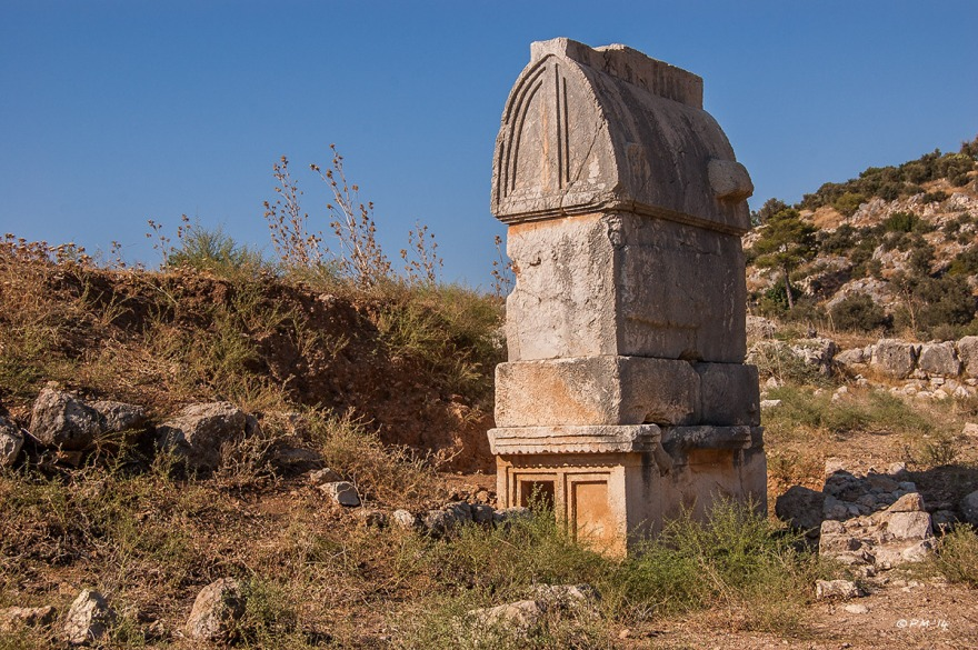 Tepecik Necropolis sarcophagus among rocks, Gelemiş, Patara, Turkey. Monochrome landscape. P.Maton 09/09/2014 eyeteeth.net