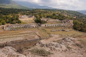 View South East over Tlos from Acropolis Hill showing amphitheater. Tlos Fethiye Turkey. Colour landscape. P.Maton 06/09/2014 eyeteeth.net