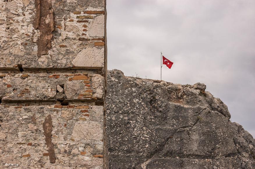 Turkish Flag on Acropolis Hill. Tlos Fethiye Turkey. Colour landscape abstract. P.Maton 06/09/2014 eyeteeth.net