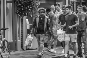 Young man wearing Bandanna walking in street with friends. Monochrome landscape. Gardener Street, Brighton, UK © P.Maton 2014 eyeteeth.net