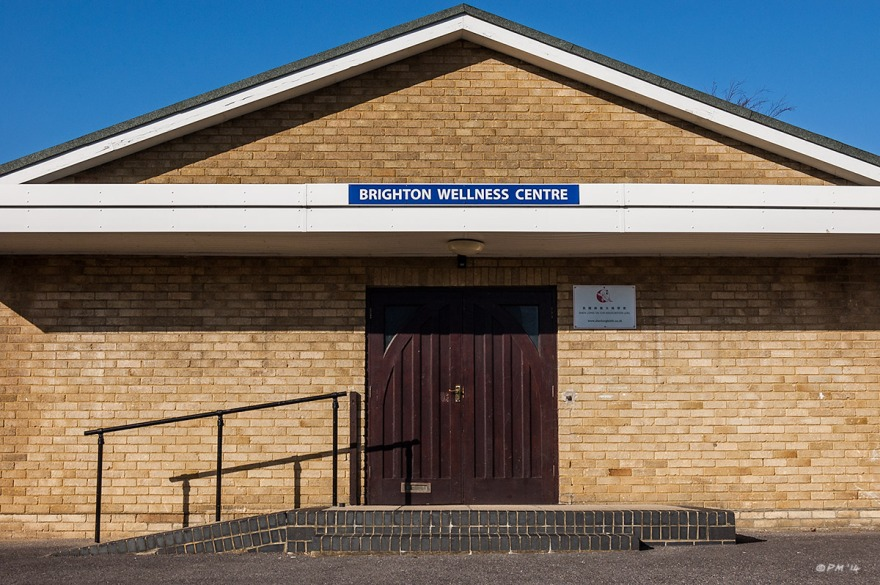 Brighton Wellness Centre Chalky Road Mile Oak Sussex, plain fronted brick building with blue sky. Colour Landscape. © P. Maton 2014 eyeteeth.net