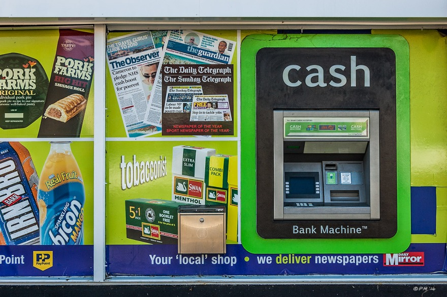 McColls general store ATM cash machine and advertising frontage, Mile Oak, Sussex. Colour Landscape. © P. Maton 2014 eyeteeth.net