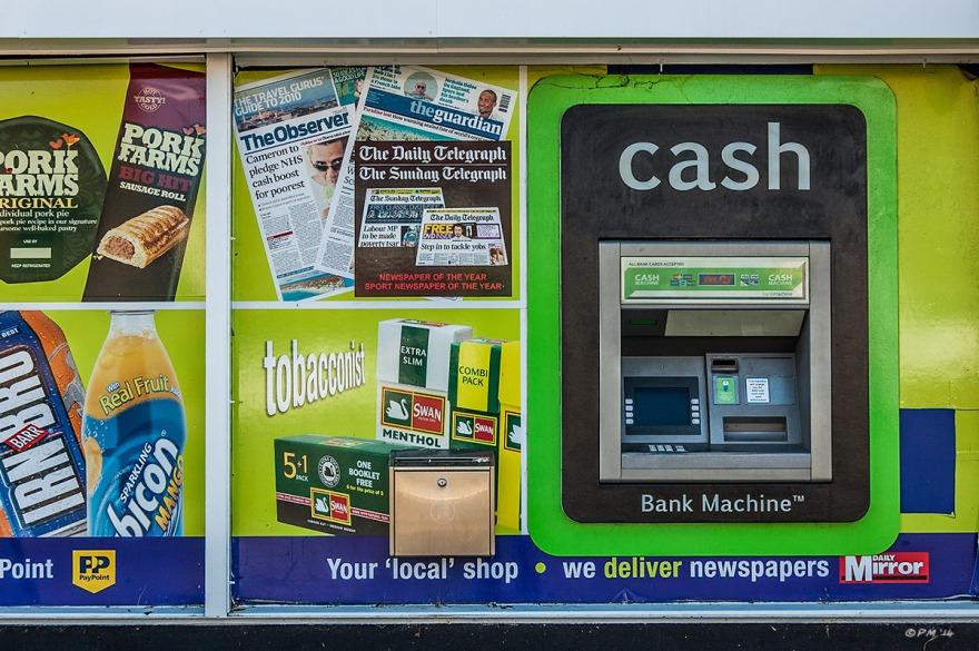 McColls general store ATM cash machine and advertising frontage, Mile Oak, Sussex. Colour Landscape. © P. Maton 2014 eyeteeth.net