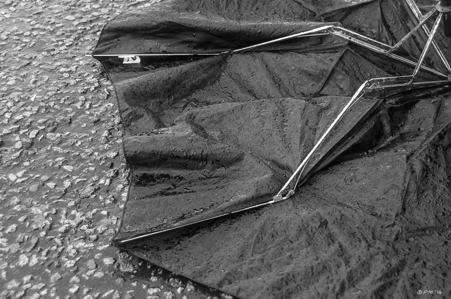 Upturned discarded umbrella on footpath in the rain. Abstract Monochrome Landscape. © P.Maton 2014 eyeteeth.net